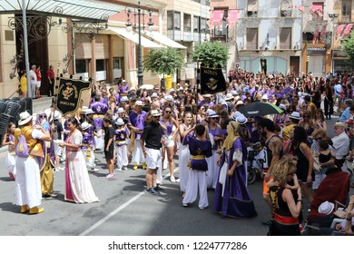 Orihuela, Spain - July 17, 2018: The Moros Almohabenos company on a street parade during the Moors and Christians (Moros y Cristianos) historical reenactment in Orihuela, Spain
