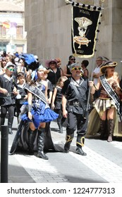 Orihuela, Spain - July 17, 2018: The Christian Pirate company on a street parade during the Moors and Christians (Moros y Cristianos) historical reenactment in Orihuela, Spain