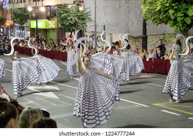 Orihuela, Spain - July 20, 2018: The dancing girls from the Christian company on a parade at the Moors and Christians (Moros y Cristianos) historical reenactment in Orihuela, Spain