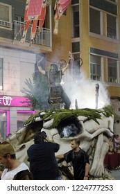 Orihuela, Spain - July 20, 2018: A man on a skull from the Christian company on a street parade at the Moors and Christians (Moros y Cristianos) reenactment in Orihuela, Spain