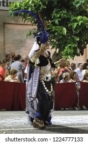 Orihuela, Spain - July 21, 2018: The Moros Almohabenos company on a street parade during the Moors and Christians (Moros y Cristianos) historical reenactment in Orihuela, Spain