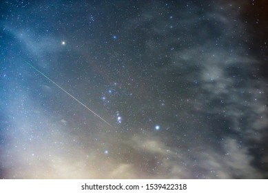 Orionids shooting stars in constellation Orion in the night sky.