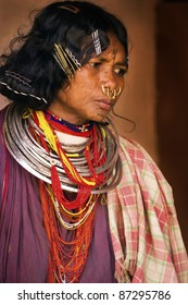 ORISSA, INDIA - FEBRUARY 6: An unidentified Indian tribal woman dresses in full ethnic dress and tribal jewelery for tribal dance in village of Orissa, India on February 6, 2011