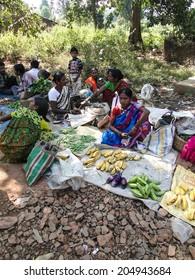 ORISSA,  INDIA - NOV 10  - Indian women sell vegetables at the  Durum weekly market on Nov 10, 2009 in Orissa, India