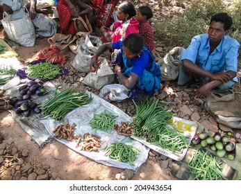 ORISSA, INDIA - NOV 10 -Tribal villagers bargain for vegetables     on Nov 10, 2009, in Chatikona market, Orissa, India