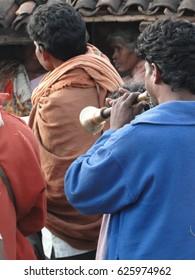 ORISSA, INDIA - NOV 11, 2009 - Villagers and musicians attend the visist of a priestess in Orissa, India