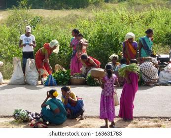 ORISSA,  INDIA - Nov 11 -Tribal women sell vegetables  in weekly market  on Nov 1, 2009 in  Orissa in India