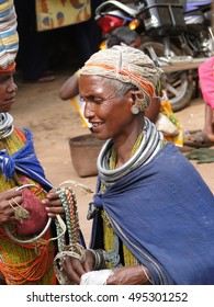 ORISSA,  INDIA - NOV 12, 2009 - Bonda tribal woman with elaborate necklaces and earrings weekly market  in Ankadeli, Orissa in India