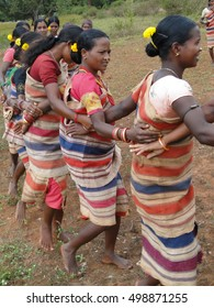 ORISSA,  INDIA - NOV 12, 2009 - Tribal women link arms for Gdaba harvest dance , in Lamptaput, Orissa, India