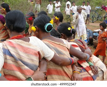 ORISSA,  INDIA - NOV 12, 2009 - Tribal women link arms for Gdaba harvest dance , in Lamptaput, Orissa, India