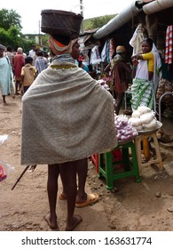 ORISSA,  INDIA - NOV 12 -Bonda tribal women shop   in the weekly market on Nov 12, 2009 in Ankadeli, Orissa in India