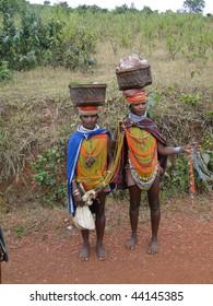 ORISSA INDIA - NOV 12 : Bonda tribal women pose for portraits on their way to the  weekly market on November 12, 2009 in Ankadeli, Orissa in India .