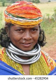 ORISSA INDIA - NOV 12 - Bonda tribal woman poses for a portrait on her way to the  weekly market on Nov 12, 2009 in Ankadeli, Orissa in India