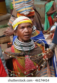 ORISSA,  INDIA - NOV. 12 : Bonda tribal women offer their handmade crafts at the  weekly market on Nov 12, 2009 in Ankadeli, Orissa in India