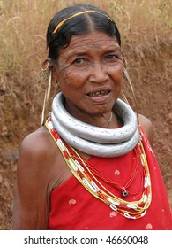 ORISSA,  INDIA - NOV 12 - Bonda tribal woman with tattoos and large earrings poses for a portrait on her way to the  weekly market on Nov 12, 2009 in Ankadeli, Orissa in India