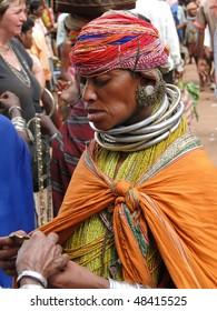 ORISSA,  INDIA - NOV 12 - Bonda tribal woman poses for a portrait on her way to the  weekly market on Nov 12, 2009 in Ankadeli, Orissa in India