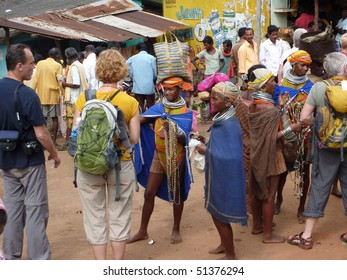 ORISSA,  INDIA - Nov 12 - Bonda tribal women offer their handmade crafts to western tourists at the  weekly market on Nov 12, 2009 in Ankadeli, Orissa in India