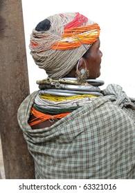 ORISSA,  INDIA - NOV 12 -Bonda tribal woman with elaborate necklaces and earrings weekly market on Nov 12, 2009 in Ankadeli, Orissa in India