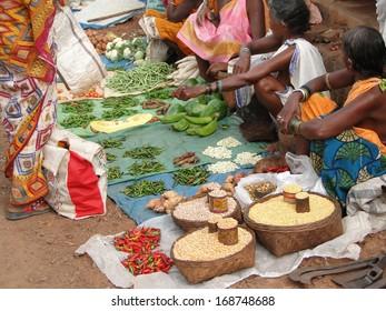 ORISSA,  INDIA - Nov 12 -Tribal women sell vegetables  in weekly market  on Nov 12, 2009 in Ankadeli, Orissa in India
