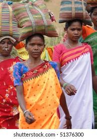 ORISSA,  INDIA - Nov 12 - Tribal women carry goods  on their heads  on Nov 12, 2009 in Ankadeli, Orissa in India