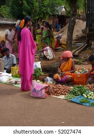 ORISSA,  INDIA - Nov 12 -Tribal woman sells vegetables  in weekly market  on Nov 12, 2009 in Ankadeli, Orissa in India