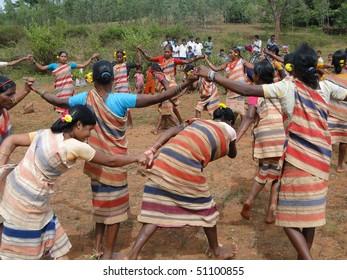 ORISSA,  INDIA - NOV 12 - Village women link arms for  Gdaba harvest dance  on Nov 12, 2009, in Lamptaput, Orissa, India