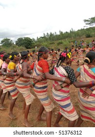 ORISSA,  INDIA - Nov 12 - Village women link arms for  Gdaba harvest dance  on Nov 12, 2009, in Lamptaput, Orissa, India