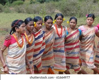ORISSA,  INDIA - NOV 12:Tribal women link arms for Gdaba harvest dance on Nov 12, 2009, in Lamptaput, Orissa, India
