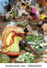 ORISSA, INDIA - NOV 13, 2009 - Tribal women sell fresh vegetables  in Orissa, India