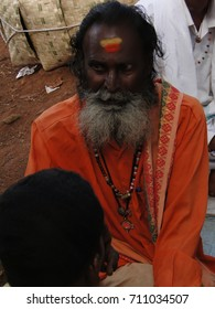ORISSA, INDIA - NOV 13, 2009 - Sadhu gives advice  on market day , in Orissa, India