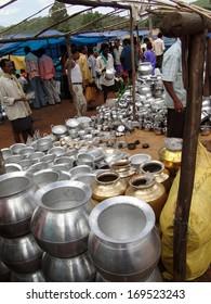 ORISSA,  INDIA - Nov 13 - Bright new kitchen pots attract buyers on Nov 13, 2009, in Chatikona market, Orissa, India