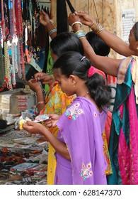 ORISSA,  INDIA - Nov 13 -Young women shop in the weekly market on Nov 13, 2009, in Chatikona market, Orissa, India .