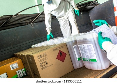 Orlandia, SP, Brazil, February 20, 2013. Workers with personal protective equipment do the loading of a truck with pesticides at the agricultural inputs store in Orlandia