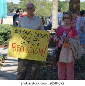 ORLANDO – APRIL 15 : Participant carries placard during Orlando tea party April 15, 2009 in Orlando, Florida. The protest is a modern-day protest to the government's spending of billions of dollars.