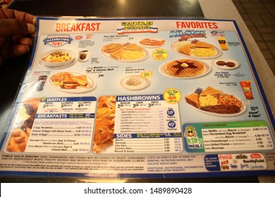 Orlando FL, August 12, 2019:  Waffle House an American restaurant chain with 2,100 locations in 25 states in the United States. Most of the locations are in the South, Waffle House Menu featured here.