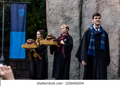 Orlando, Fl/ Dec 12, 2018: Universal Studios Harry potter world Hogsmede Hogwarts acapella group houses frog Christmas musical song singing