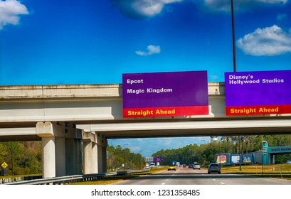 ORLANDO, FL - FEBRUARY 19, 2016: Disney parks road signs in Orlando. Disney has the most famous amusement parks in Florida.