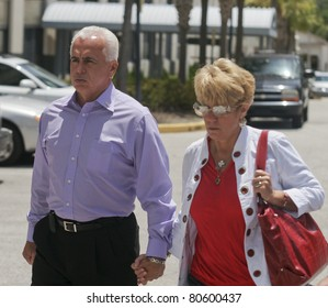ORLANDO, FL - JULY 4:The parents of accused murderer Casey Anthony exits from the Orange County courthouse. Casey is accused of murdering her daughter Caylee Marie Anthony in Orlando, FL July 4, 2011.