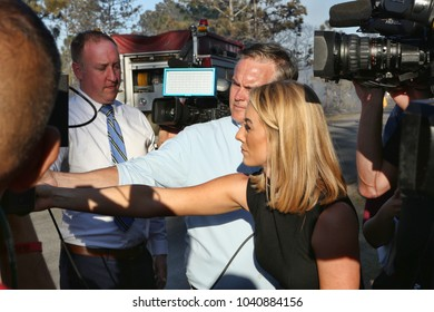 Orlando, FL.  March 2018 - the local media crowd the Orange County Fire Rescue Department's spokesperson answering questions about a 4-acre fire in Orlando's Wedgefield subdivision.