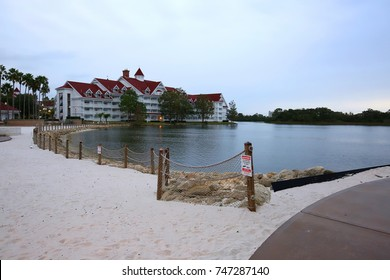 ORLANDO, FL - OCTOBER 28:  Sign posted at the water's edge at the Grand Floridian Resort and Spa, warning visitors of the danger of alligators and snakes in the area as seen on October 28, 2017.