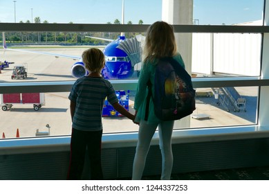 Orlando, FL / USA - 11/21/2018: Bored kids waiting for a delayed airplane flight