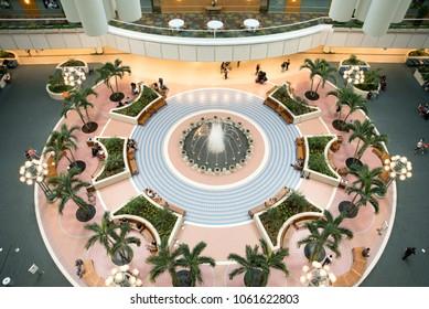 Orlando, FL  / USA - April 3, 2018:  Atrium lobby of Orlando International Airport and Hyatt Regency Orlando International Airport on A-Side by security gates with passengers relaxing and waiting