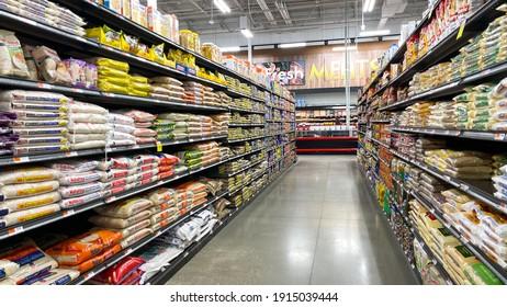 Orlando, FL USA - December 27, 2020: The rice aisles of a Bravo Market grocery store in Orlando, Florida.