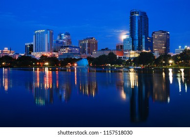 Orlando, FL USA July 13, 2011 A full moon and the skyline of Orlando,  Florida are reflected in the waters of Lake Eola
