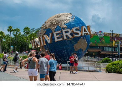 Orlando, Florida. August 07, 2019. People taking photos next to Universal sphere at Universal Studios area 1