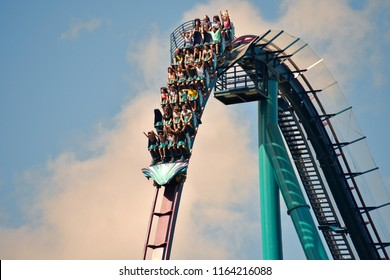 Orlando, Florida; August 25, 2018 Young people having fun on rollercoaster.
