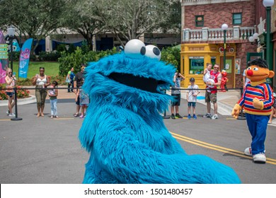 Orlando, Florida. August 28, 2019. Cookie Monster dancing in Sesame Street Party Parade at Seaworld 3