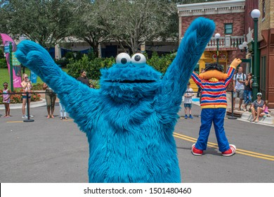 Orlando, Florida. August 28, 2019. Cookie Monster dancing in Sesame Street Party Parade at Seaworld 6