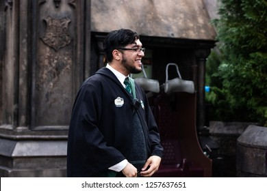 orlando, florida/ dec 13, 2018: slytherin harry potter universal studios guy with glasses welcoming people into the Hogwarts ride in hogsmeade
