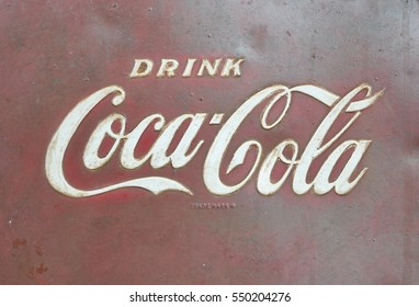 Orlando, Florida - December 22, 2016: Sign of Coca-Cola painted in a rusty and old metal.